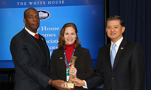 VA Secretary Eric Shinseki (right) presents the Abraham Lincoln Pillars of Excellence Award to Alabama Department of Veterans Affairs General Counsel, Sandy Speakman, and Alabama VA Commissioner W. Clyde Marsh.