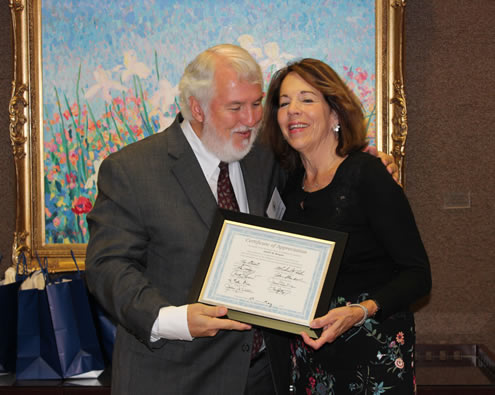 Harold Stephens, Chair of the Alabama Supreme Court Commission on Dispute Resolution, filling in for Justice Murdock, presents outgoing Executive Director Judy Keegan with a Certificate of Appreciation for her years of service for the Supreme Court of Alabama.